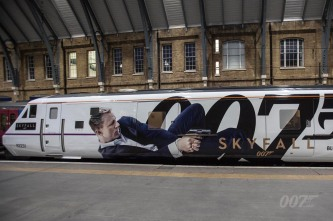 Today, a train named after Bond film SKYFALL was unveiled at King's Cross Station. It's the first time a film has permanently given its name to a train. The East Coast London to Edinburgh service, train number 91007, has been renamed SKYFALL with each of its eleven carriages wrapped in SKYFALL artwork.