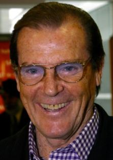 ROGER MOORE AND WIFE KIKI DEPART LONDON AFTER HIS ORDEAL IN NEW YORK.PIX RUSSELL CLISBY.